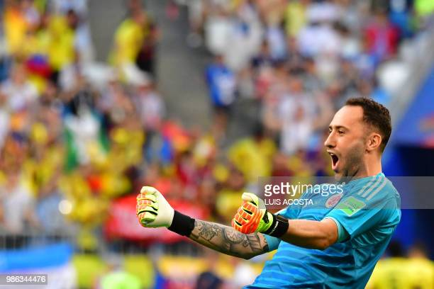 TOPSHOT Colombia's goalkeeper David Ospina celebrates his team's goal during the Russia 2018 World Cup Group H football match between Senegal and...
