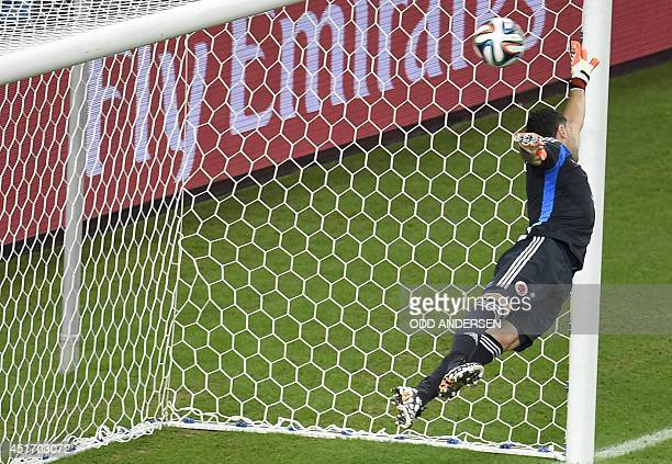 Colombia's goalkeeper David Ospina concedes a second goal during the quarterfinal football match between Brazil and Colombia at the Castelao Stadium...