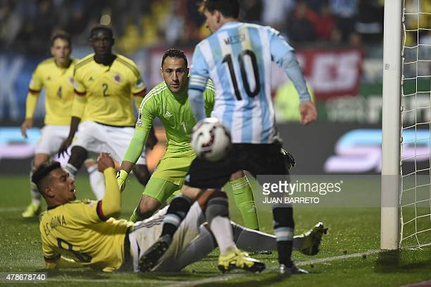 Colombia's goalkeeper David Ospina eyes the ball during the 2015 Copa America football championship quarterfinal match against Argentina in Viña del...