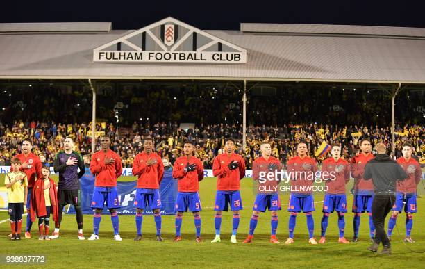 Colombia's goalkeeper David Ospina stands with teammates as they sing the national anthem ahead of the International friendly football match between...