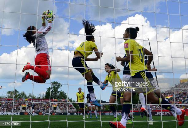 Colombia's goalkeeper Sandra Sepulveda stops the ball during a Group F match at the 2015 FIFA Women's World Cup between France and Colombia at...