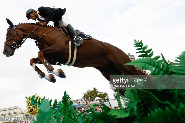 Colombia's horseman Carlos Enrique Lopez Lizarazo steers his horse Ulhane De Conde as they compete in the Longines FEI Jumping Nations Cup Final at...