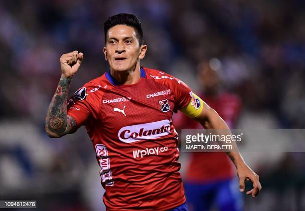 Colombia´s Independiente de Medellin footballer German Cano celebrates his goal during their Copa Libertadores football match against Chile's...