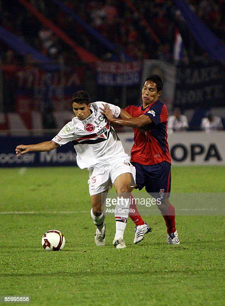 Colombia's Independiente Medellin Jhon Javier Restrepo fights for the ball against Brazil's Sao Paulo Jean during their Santander Libertadores Cup...