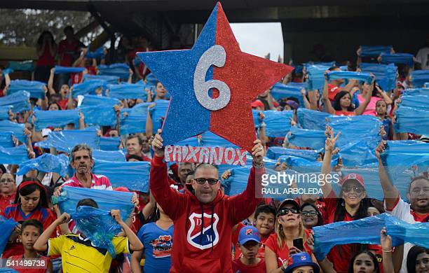 Colombia's Independiente Medellin supporters cheer for their team before the start of their Colombian Football League final match against Junior at...