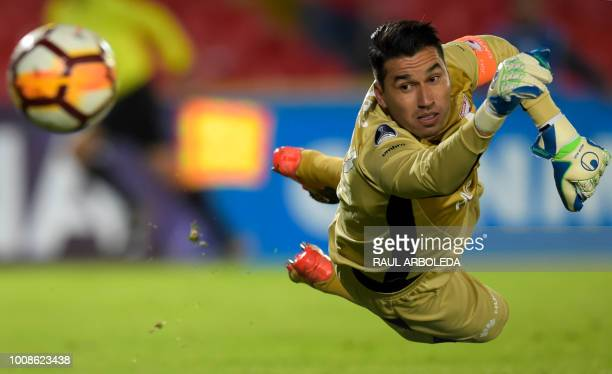 Colombia's Independiente Santa Fe goalkeeper Leandro Castellanos tries the stop a ball during a Copa Sudamericana football match against Uruguay's...