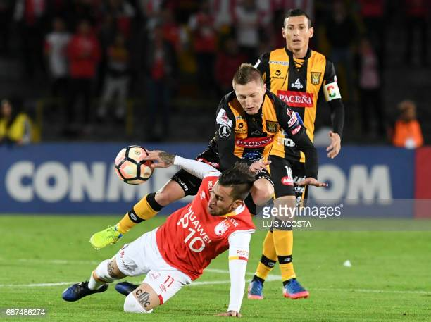 Colombia's Independiente Santa Fe player Jonathan Gomez vies for the ball with Bolivia's The Strongest player Alejandro Chumacero during their...