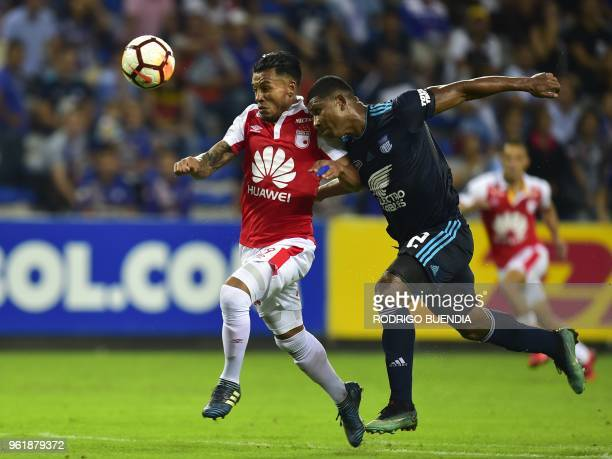 Colombia's Independiente Santa Fe player Wilson Morelo vies for the ball with Ecuador's Emelec player Jorge Guagua during their Copa Libertadores...