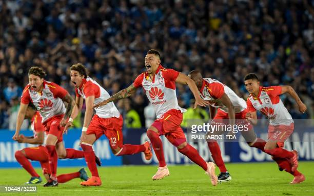 Colombia's Independiente Santa Fe players celebrate at the end of their Copa Sudamericana football match against Colombia's Millonarios at the...