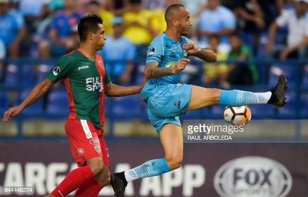 Colombia's Jaguares player Juan Zuluaga vies for the ball with Uruguay's Boston River player Pablo Adorno during their Copa Sudamericana football...