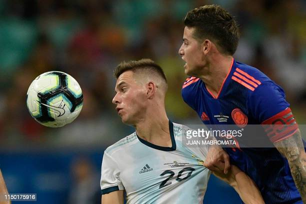 TOPSHOT Colombia's James Rodriguez and Argentina's Giovani Lo Celso vie for the ball during their Copa America football tournament group match at the...