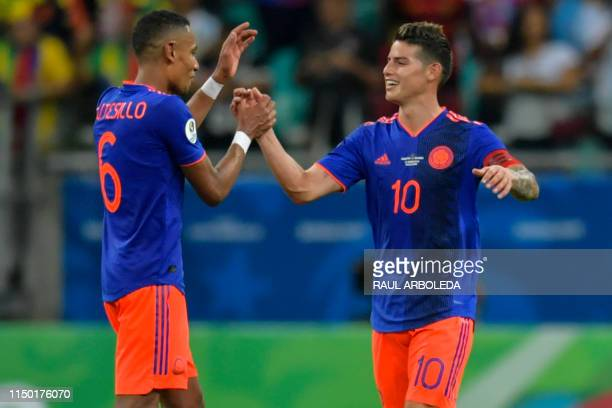 Colombia's James Rodriguez and teammate William Tesillo celebrate after defeating Argentina 20 in a Copa America football tournament group match at...