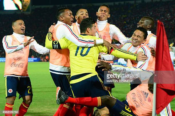 Colombia's James Rodriguez celebrates with teammates after scoring against Chile during their Russia 2018 FIFA World Cup South American Qualifiers...