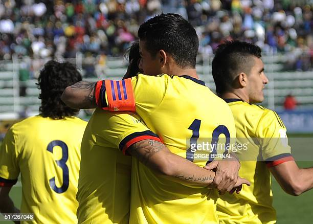 Colombia's James Rodriguez celebrates with teammates after scoring against Bolivia during their Russia 2018 FIFA World Cup South American Qualifiers'...