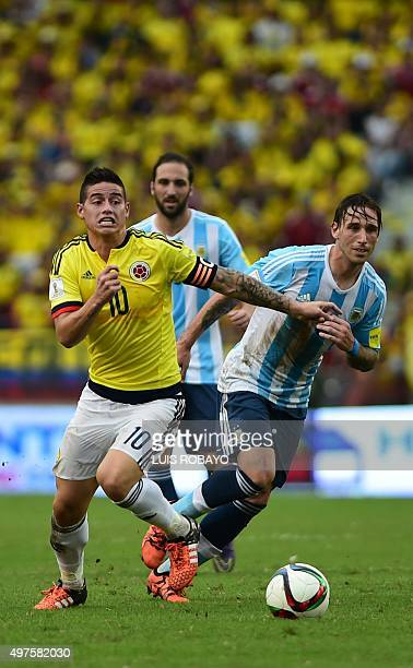 Colombia's James Rodriguez drives the ball past Argentina's Lucas Biglia during their Russia 2018 FIFA World Cup South American Qualifiers football...