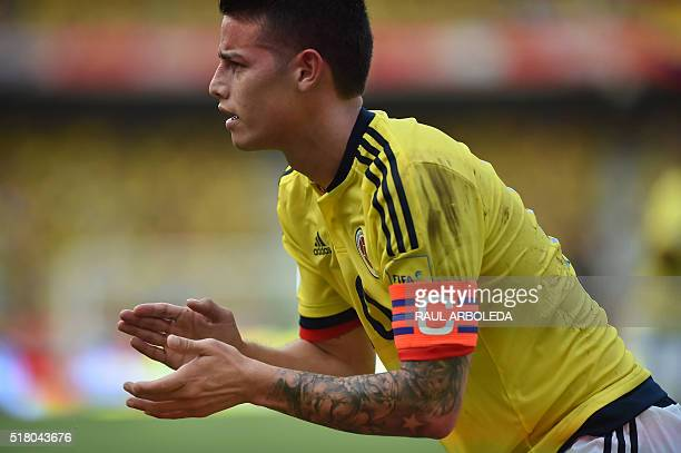 Colombia's James Rodriguez encourages a teammate during the Russia 2018 FIFA World Cup South American Qualifiers' football match against Ecuador in...