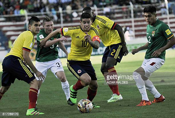 Colombia's James Rodriguez takes control of the ball over Bolivia's Alejandro Chumacero during their Russia 2018 FIFA World Cup South American...