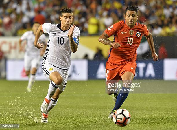 Colombia's James Rodriguez vies for the ball with Chile's Gonzalo Jara during a Copa America Centenario semifinal football match in Chicago Illinois...