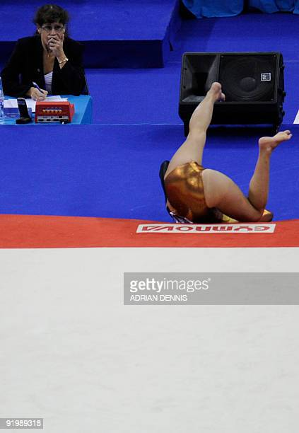 Colombia's Jessica Gil Ortiz falls as she performs in the women's floor event in the apparatus finals during the Artistic Gymnastics World...