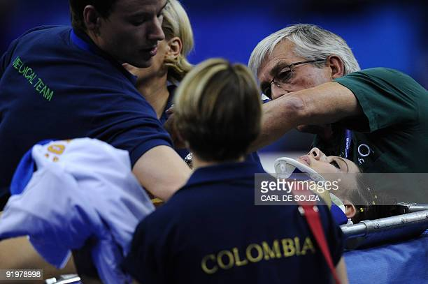 Colombia's Jessica Gil Ortiz is taken away by paramedics after falling during the floor event in the apparatus finals during the Artistic Gymnastics...