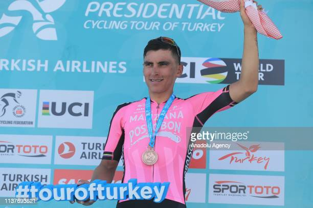 Colombia's Jhonatan Restrepo, riding for the Manzana Postobon team, poses for a photo on the podium after finishing third in the second stage of...