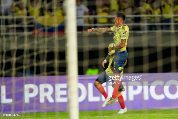 Colombia's Jorge Carrascal celebrates a goal during their CONMEBOL PreOlympic soccer game against Argentina at the Hernan Ramirez Villegas Stadium on...