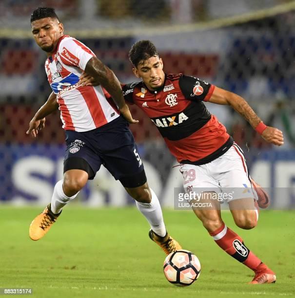 Colombia's Junior defender Rafael Perez vies for the ball with Brazil's Flamengo forward Lucas Paqueta during the Copa Sudamericana semifinal second...