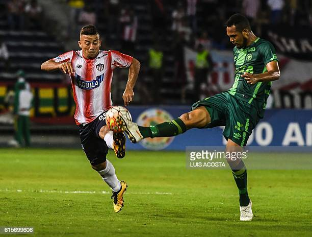 Colombia's Junior footballer Leiner Escalante vies for the ball with Brazil's Chapecoense player William Thiego during their Copa Sudamericana...