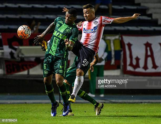 Colombia's Junior footballer Leiner Escalante vies for the ball with Brazil's Chapecoense player Dener during their Copa Sudamericana football match...
