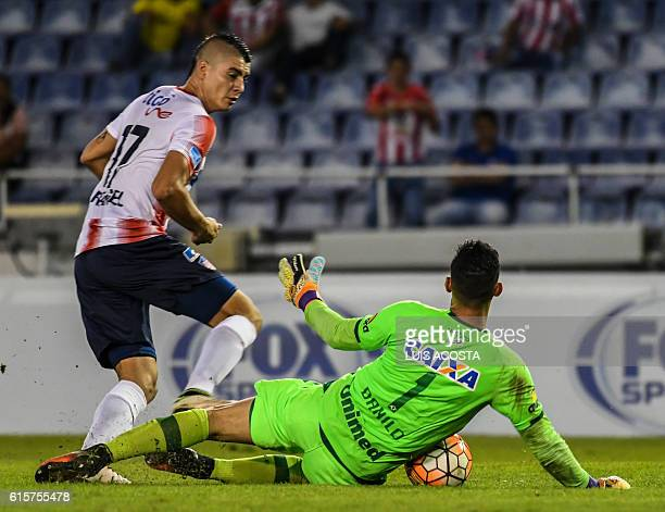Colombia's Junior footballer Michael Rangel vies for the ball with Brazil's Chapecoense goalkeeper Danilo during their Copa Sudamericana football...