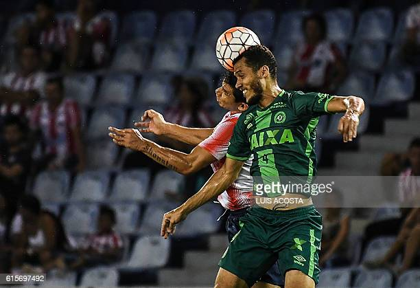 Colombia's Junior footballer Roberto Ovelar vies for the ball with Brazil's Chapecoense player Neto during their Copa Sudamericana football match at...