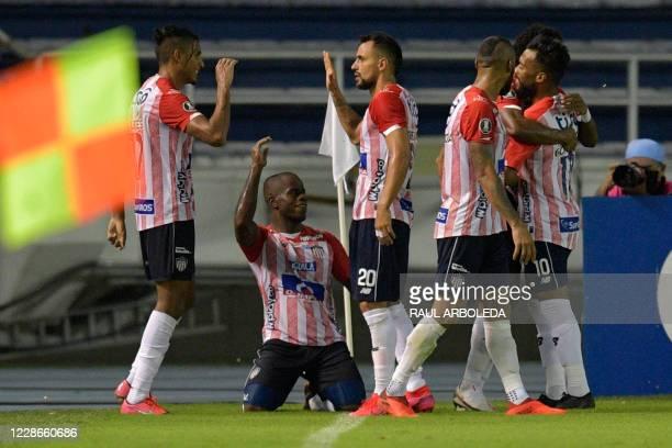 Colombia's Junior forward Carmelo Valencia celebrates with teammates after scoring against Ecuador's Independiente del Valle during their closed-door...