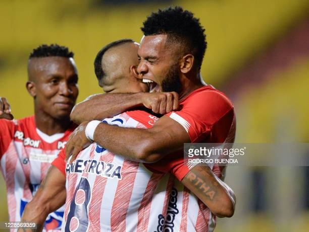 Colombia's Junior forward Miguel Angel Borja celebrates with midfielder Fredy Hinestroza after scoring against Ecuador's Barcelona during their...