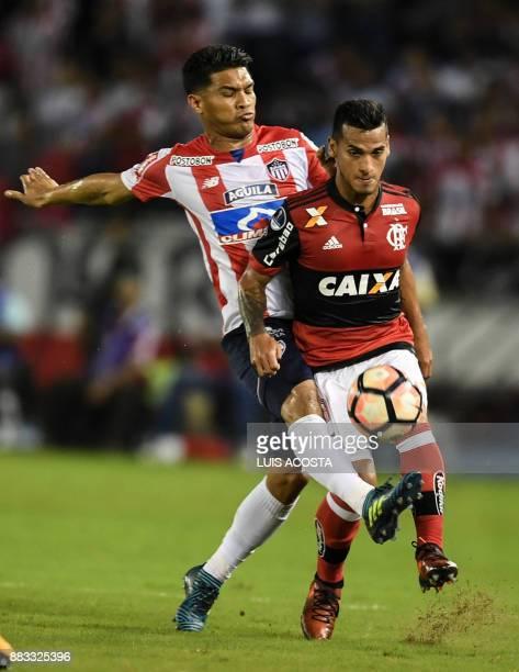 Colombia's Junior forward Teofilo Gutierrez and Brazil's Flamengo defender Peruvian Miguel Trauco vie for the ball during the Copa Sudamericana...