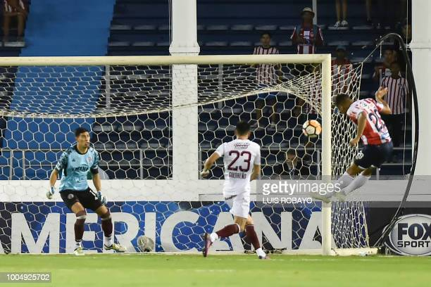 Colombia's Junior forward Teofilo Gutierrez jumps for a header towards the goal of Argentina's Lanus Esteban Andrada during their Copa Sudamericana...