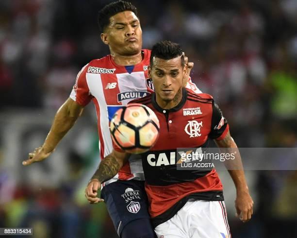 Colombia's Junior forward Teofilo Gutierrez vies for the ball with Brazil's Flamengo defender Peruvian Miguel Trauco during the Copa Sudamericana...