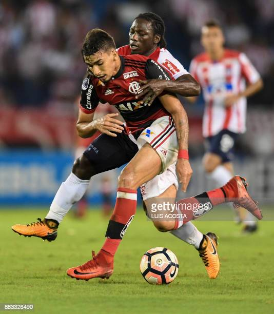 Colombia's Junior forward Yimmi Chara and Brazil's Flamengo forward Lucas Paqueta vie for the ball during the Copa Sudamericana semifinal second leg...