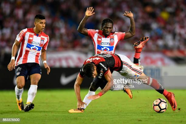 Colombia's Junior forward Yimmi Chara vies for the ball with Brazil's Flamengo forward Lucas Paqueta during their Copa Sudamericana semifinal second...