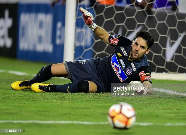 Colombia's Junior goalkeeper Sebastian Viera stops a penalty kick during a Copa Sudamericana football match against Argentina's Lanus at Roberto...