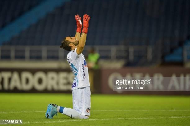 Colombia's Junior goalkeeper, Uruguayan Sebastian Viera celebrates after his team scored against Ecuador's Independiente del Valle during their...