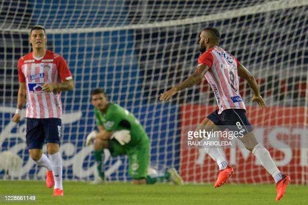 Colombia's Junior midfielder Fredy Hinestroza celebrates after scoring against Ecuador's Independiente del Valle during their closed-door Copa...