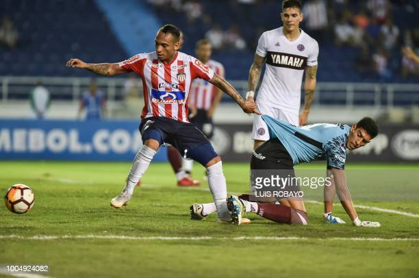 Colombia's Junior midfielder Jarlan Barrera vies for the ball with Argentina's Lanus goalkeeper Esteban Andrada during their Copa Sudamericana...