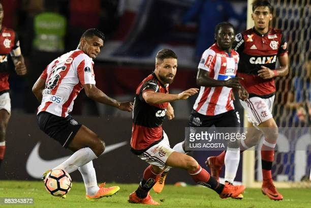 Colombia's Junior midfielder Luis Narvaez and Brazil's Flamengo midfielder Diego eye the ball during the Copa Sudamericana semifinal second leg...