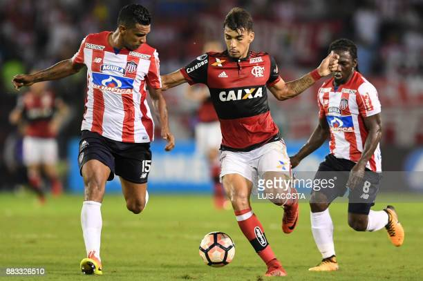 Colombia's Junior midfielder Luis Narvaez vies for the ball with Brazil's Flamengo forward Lucas Paqueta during their Copa Sudamericana semifinal...