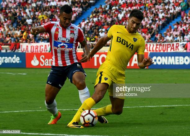 Colombia's Junior player German Gutierrez vies for the ball with Argentina's Boca Juniors player Lisandro Magallan during their Copa Libertadores...