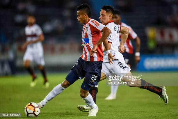 Colombia's Junior player Luis Diaz vies for the ball with Argentina's Colon player Gustavo Toledo during their Copa Sudamericana football match at...