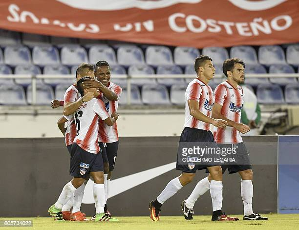 Colombia's Junior player Yony Gonzalez celebrates with teammates after scoring against Bolivia's Blooming during their Copa Sudamericana 2016...