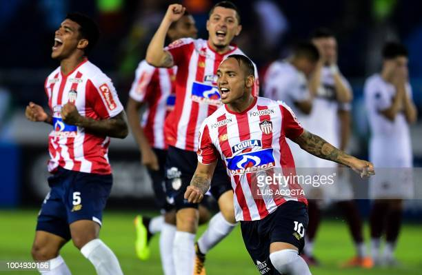 Colombia's Junior players celebrate their victory after a Copa Sudamericana football match against Argentina's Lanus at Roberto Melendez stadium in...