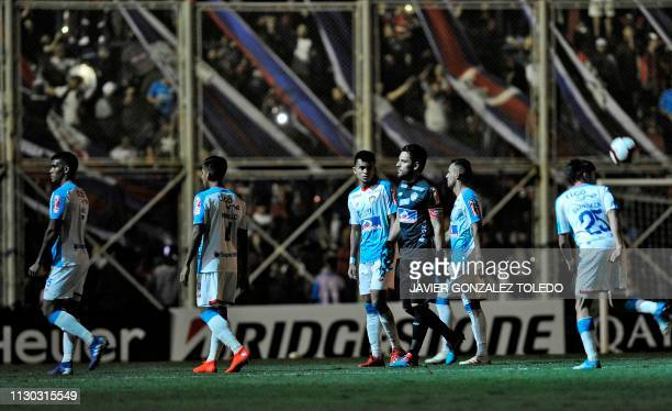 Colombia's Junior players wait during a blackout in a Copa Libertadores Group F football match against Argentina's San Lorenzo at Pedro Bidegain...