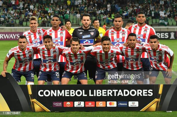Colombia's Junior team players pose before their 2019 Copa Libertadores football match against Brazil's Palmeiras held at Allianz Parque stadium in...